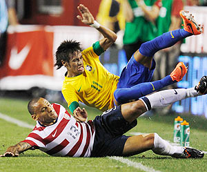 Neymarof Brazil and Jermaine Jones of USA