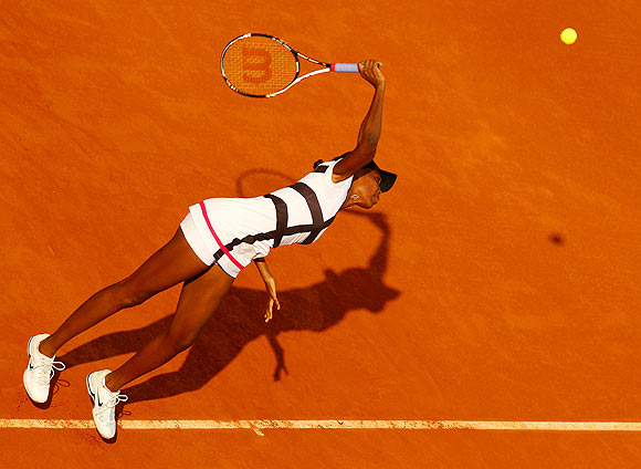 Venus Williams of USA serves
