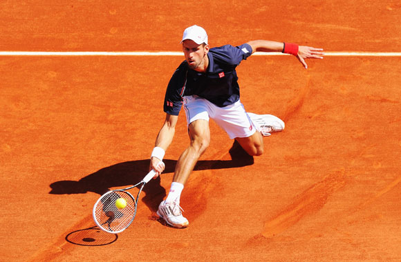 Novak Djokovic of Serbia in action in his men's singles second round match against Blaz Kavcic of Slovenia