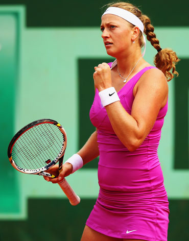 Petra Kvitova of Czech Republic celebrates a point in her women's singles second round match against Urszula Radwanska of Poland during day 5 of the French Open at Roland Garros