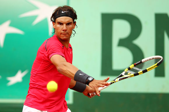Rafael Nadal of Spain plays a forehand during his men's singles second round match against Denis Istomin of Uzbekistan