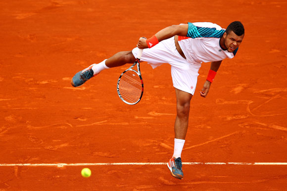 Jo-Wilfried Tsonga of France serves during his men's singles second round match against Cedrik- Marcel Stebe of Germany