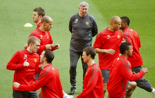 Manchester United manager Ferguson watches his players during training