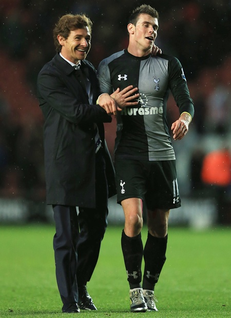 Manager Andre Villas Boas of Tottenham hugs Gareth Bale