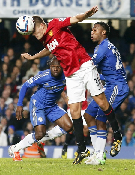 Manchester United's Scott Wootton heads the ball past Chelsea's Victor Moses