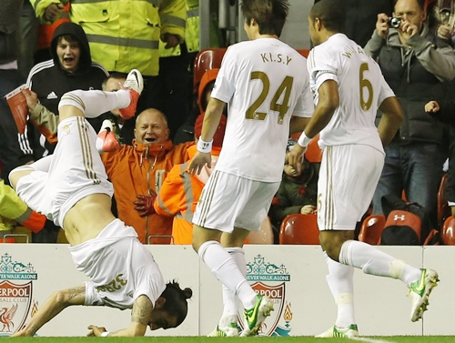 Swansea's Chico Flores (left) celebrates his goal against Liverpool