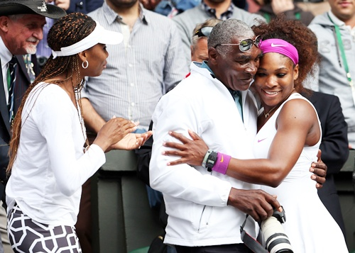 Serena Williams (right) of the USA with her father Richard Williams and sister Venus Williams