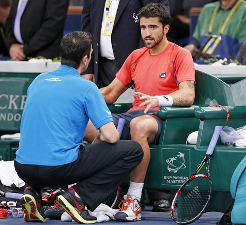 Janko Tipsarevic of Serbia receives medical attention
