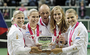 Czech Republic's team members (from left to right) Andrea Hlavackova, Lucie Hradecka, captain Patr Pala, Petra Kvitova and Lucie Safarova celebrate with the trophy after winning their final match of the Fed Cup tennis tournament against Serbia