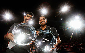 Mahesh Bhupathi (R) and Rohan Bopanna of India pose with their trophy after victory at the Paris Masters on Sunday