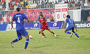 Pune FC's Daisuke Nishiguchi in action during their match against Churchill Brothers on Sunday