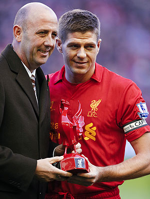 Liverpool captain Steven Gerrard (right) is presented with a statue of a Liver bird by former player Gary McCallister as he makes his 600th appearance in the English Premier League soccer match against Newcastle United on Sunday