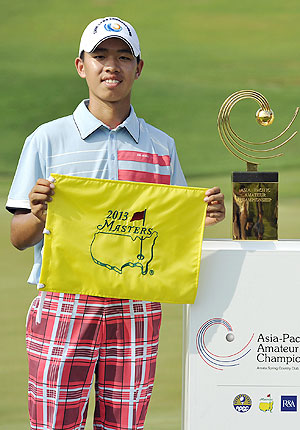 Guan Tianlang of China holds a certificate of invitation to the 2013 US Masters Tournament