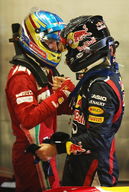 Fernando Alonso with Sebastian Vettel