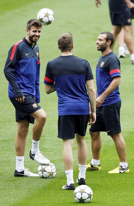 Barcelona's Gerard Pique, Marc Bartra and Javier Mascherano