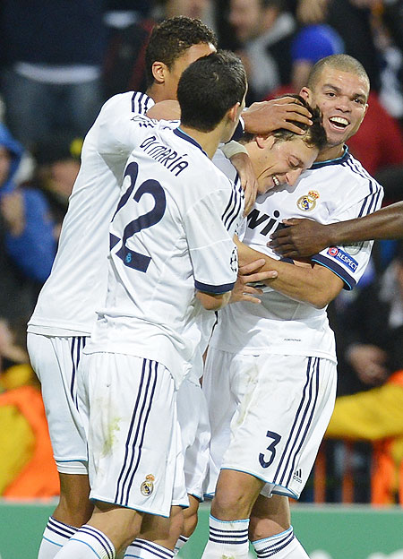 Real Madrid's Mesut Ozil (2nd from right) celebrates with teammates after scoring a last minute equaliser against Borussia Dortmund