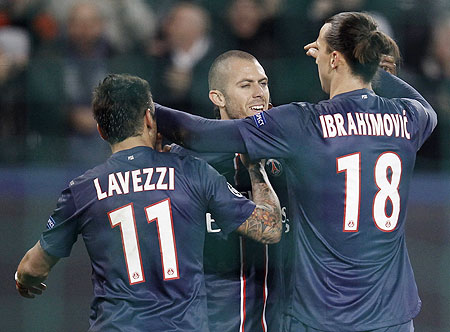 Paris St Germain's Jeremy Menez (centre) celebrates with teammates Ezequiel Lavezzi and Zlatan Ibrahimovic after he scoring