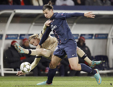 Paris St Germain's Zlatan Ibrahimovic (right) challenges Dinamo Zagreb's Domagoj Vida