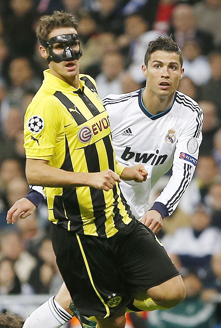 Borussia Dortmund's captain Sebastian Kehl (left) and Real Madrid's Cristiano Ronaldo react during their Champions League match