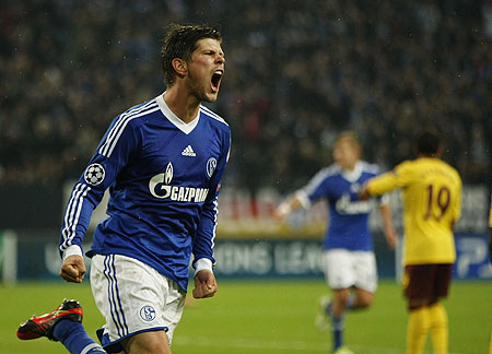 Schalke 04's Klaas-Jan Huntelaar celebrates after scoring against Arsenal