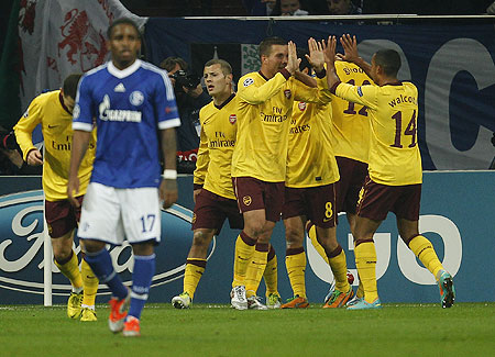 Arsenal's players celebrate after netting against Schalke 04