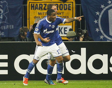 Schalke 04's Jefferson Farfan and Benedikt Hoewedes (right) celebrate a goal against Arsenal