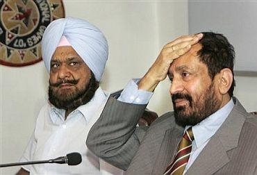 Randhir Singh with former IOA president Suresh Kalmadi