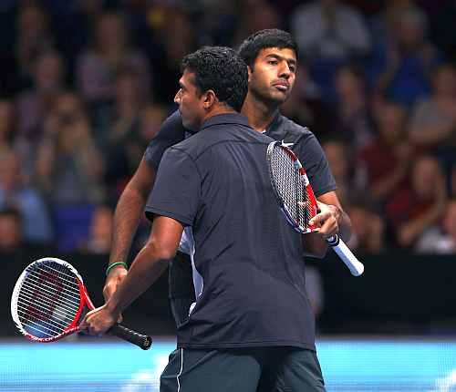 Rohan Bopanna of India and Mahesh Bhupathi of India celebrate their victory during the men's doubles match against Robert Lindstedt of Sweden and Horia Tecau of Romania