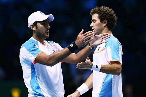 Aisam-Ul-Haq Qureshi of Pakistan and Jean-Julien Rojer of Netherlands react during the men's doubles match