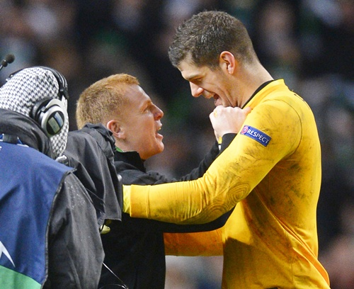 Celtic's manager Neil Lennon celebrates at the final whistle with Fraser Forster