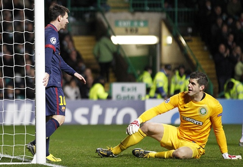 Barcelona's Lionel Messi looks down at Celtic goalkeeper Fraser Forster