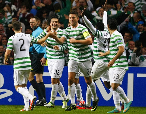 Celtic's Tony Watt (third left) celebrates scoring a goal with his teammates