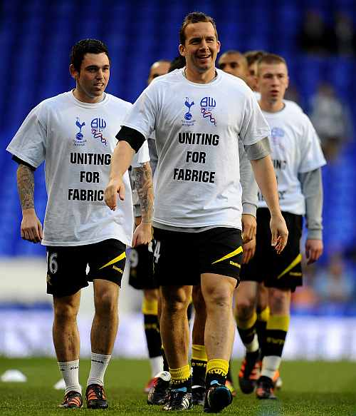 Kevin Davies of Bolton warms up with teammmates wearing t-shirts in support of teammate Fabrice Muamba