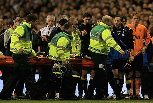 Fabrice Muamba of Bolton Wanderers is taken off on a stretcher, still unconscious after receiving CPR treatment on the pitch