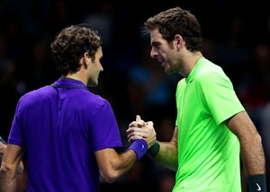 Juan Martin Del Potro shakes hands at the net with Roger Federer