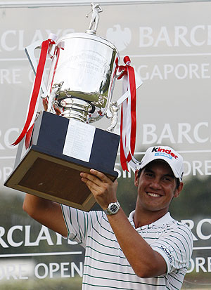 Matteo Manassero of Italy with his trophy after winning the Singapore Open golf tournament in Sentosa on Sunday
