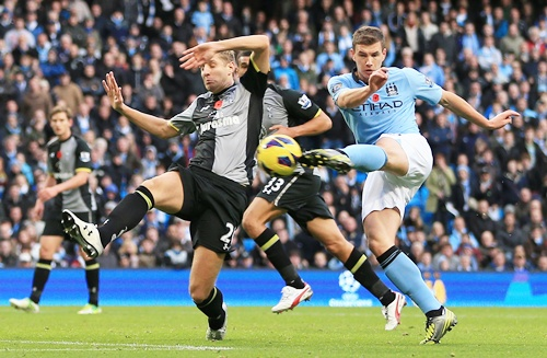 Edin Dzeko of Manchester City scores