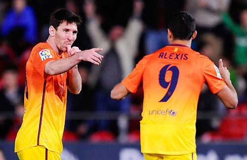Barcelona's Lionel Messi celebrates after scoring against Real Mallorca on Sunday