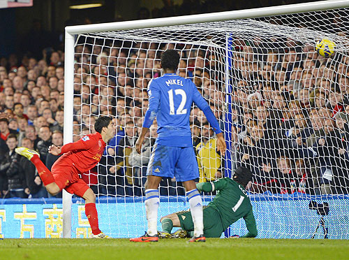 Liverpool's Luis Suarez (left) heads to score against Chelsea during their Premier League match at Stamford Bridge on Sunday