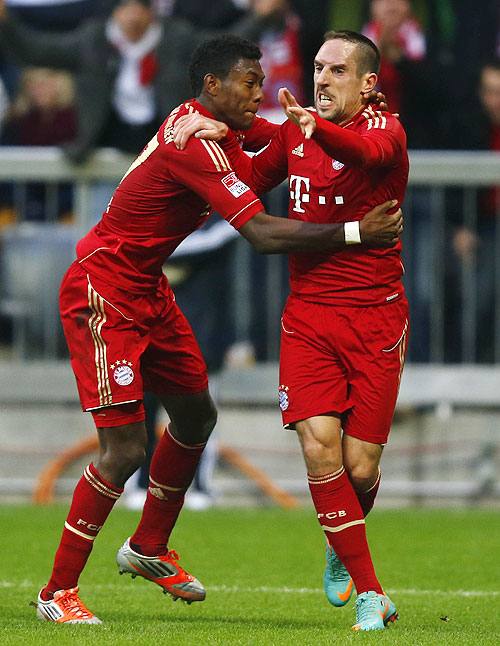Franck Ribery (right) of Bayern Munich celebrates with teammate David Alaba after scoring against Eintracht Frankfurt