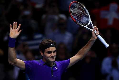 Roger Federer celebrates match point during his men's singles semi-final match against Andy Murray