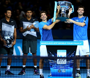 Marcel Granollers and Marc Lopez with the trophy