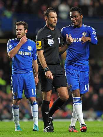Mark Clattenburg with Mikel
