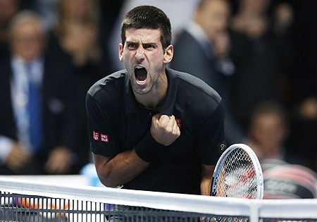 Serbia's Novak Djokovic celebrates beating Switzerland's Roger Federer in their final at the ATP World Tour Finals on Monday