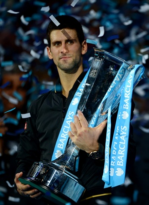 Novak Djokovic of Serbia lifts the trophy after the men's singles final against Roger Federer of Switzerland at the ATP World Tour Finals