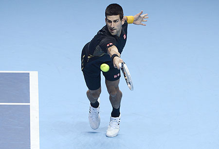 Serbia's Novak Djokovic plays return against Switzerland's Roger Federer during their final of the ATP World Tour Finals on Tuesday
