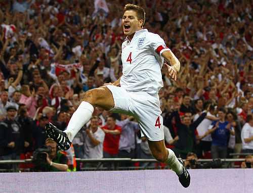 Steven Gerrard of England celebrates after scoring
