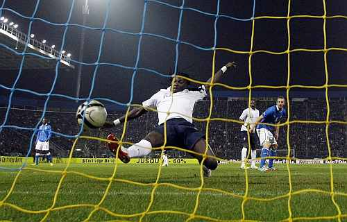France's Bafetimbi Gomis (C) shoots to score a second goal against Italy