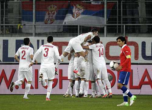 Serbia's players celebrate after scoring during their internatioanl friendly soccer match