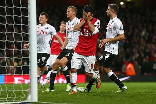 Mikel Arteta of Arsenal reacts after missing a match winning penalty kick